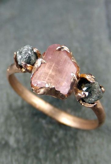 Raw stones are so romantic, probably not an engagement ring but gorgeous as a gift.