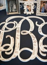 This is a lovely idea; have your guests sign a monogram and hang up in your first house.